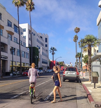 A rare sight for LA: only bicycle and pedestrian on the street, no moving cars...