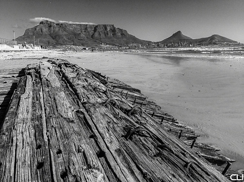 Milnerton beach, old shipwreck, Table Mountain and Lion's Head.