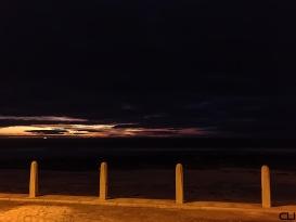 Ship on the horizon at twilight.